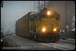 UP 603 leading a south bound Costa Mesa switcher along Olive Street on a foggy morning in March 2007