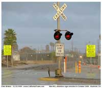 Just after the arrival of the first RCL platform units at West Anaheim, these yellow signs seemingly sprouted out of the ground all along the line. First photo is looking east across Lincoln Ave.