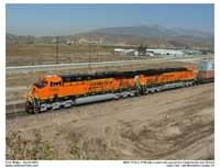 "Two new Gevos with BNSF's ""New Image"" logo pull passed the Cargil facility as seen from Cargil Hill"