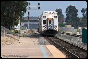 SCAX 604 arrives at the Irvine Transportation Center with a train bound for Los Angeles.