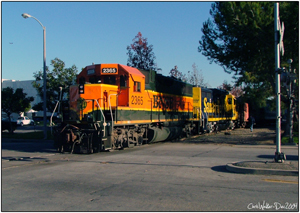 BNSF 2365 crossing Valencia as they make a run around their train to reposition the caboose.