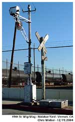 Photo of the wig-wag and it replacement signal. The original was removed illegally by a few over zealous railfans years ago.