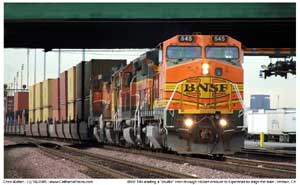 BNSF 545 working a Watson yard job shuttle train taking a stack train out to Esperanza for staging. Seen here passing under the 710 at East Hobart