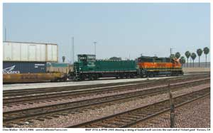 BNSF 2736 and a Green Goat RRPX 2405 shove a section of this stack train back into the east end of Hobart yard.