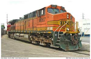 * Another image as the BNSF 4067 crosses Maywood Street on the LAJ A yard lead with the M-BARLAC interchange train.