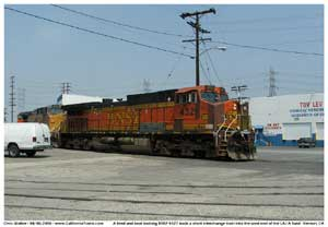* A battered and primered BNSF 4321 is seen here bringing the M-BARLAC onto the LAJ A yard lead wit a UP engine second in consist.