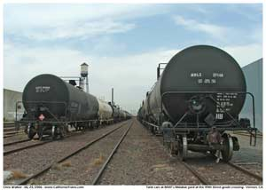 * Two long strings of tank cars seen in the Malabar yard from the 49th Street grade crossing.