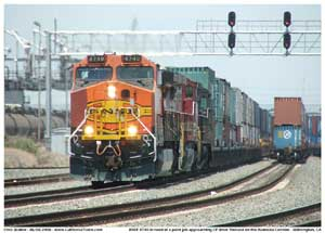 A half primered BNSF 4740 leads a stack train of mostly China Shipping containers towares CP West Thenard just across the Wilmington city line