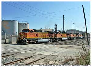 BNSF 4755 takes a stack train north through CP West Thenard next to the Vallero asphalt plant.
