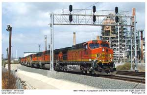 BNSF 4998 travels under the signals at CP Long Beach Jct. heading for Terminal Island