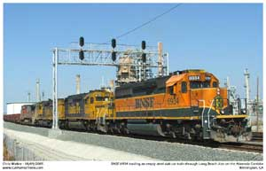 BNSF 6934 leads a train of empty steel slab cars through CP Long Beach Jct. enroute to Pasha on Pier A for loading.