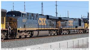 CSX 5257 & CSX 5279 head two Terminal Island sandwiched between some UP engines at CP Long Beach Jct.