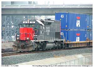 PHL 50 pulls a string of APL loaded well cars towards CP Long Beach Jct.