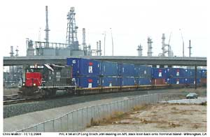 Another image of PHL 50 with a string of APL loaded well cars towards CP Long Beach Jct.